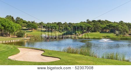 Sports Golf Park In Portugal. Near Lake And Fountain.