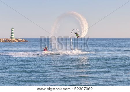 Athlete On Flyboard Making Acrobatic Figures. In The Port Of Marina Vilamoura Portugal.