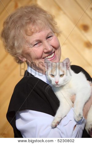Smiling Aged Woman With Cat On Hands