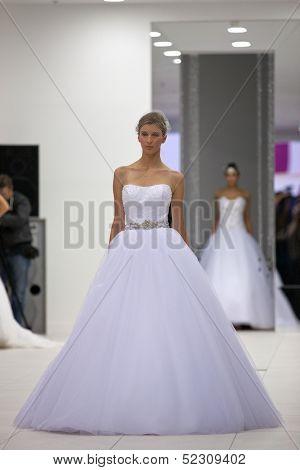 ZAGREB, CROATIA - OCTOBER 12: Fashion model wears wedding dress at 'Wedding expo' fashion show, on OCTOBER 12, 2013 in Zagreb, Croatia.