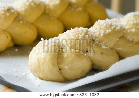 Braided sweet bread on a baking sheet