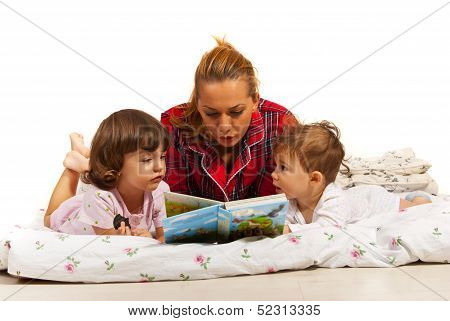 Mother Reading Story To Kids