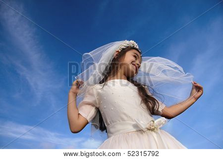 Girl In Holy Communion Dress