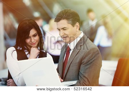 Two bussiness partners man and woman over team background