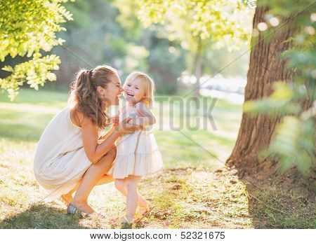 Portrait Of Happy Mother And Baby Playing Outdoors