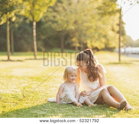 Mother And Baby Relaxing In Park