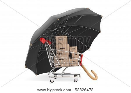 Logistics Concept. Shopping Cart With Boxes Being Protected By An Umbrella