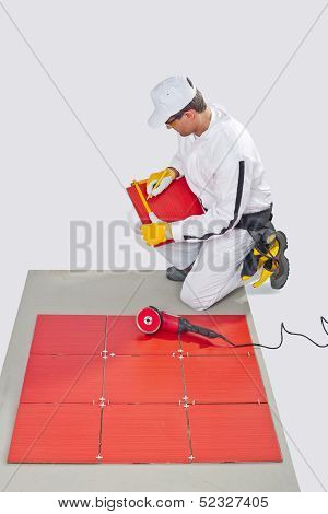 Worker cut ceramic tile machine