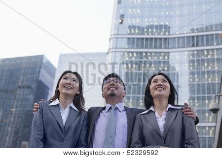 Portrait of smiling business people in a row outdoors