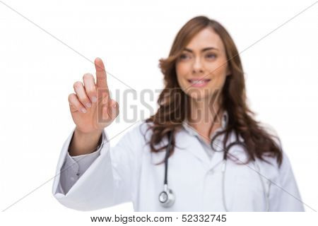 Female doctor touching something in the air on white background