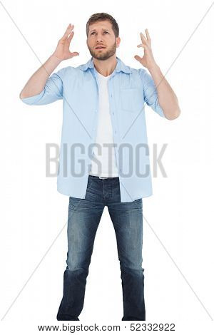 Reproachful man looking up on white background