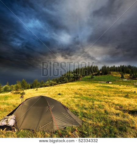 Touristic Tent And Storm Clouds