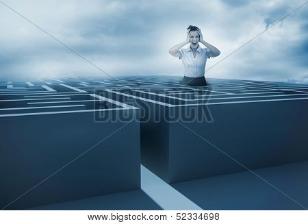 Businesswoman screaming and getting lost in a maze with dark sky on the background