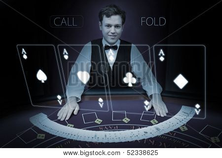 Picture of croupier standing behind holographic cards in dark room