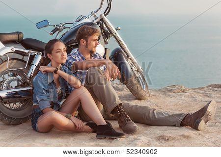 Biker man and girl