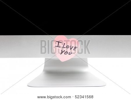 PC with a sticky note in the shape of a heart