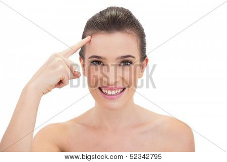 Pleased natural brown haired model touching her brow on white background