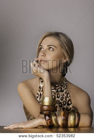 Portrait of beautiful blonde woman in safari clothing an accessories