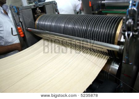 The Dough Passes Through The Specially Designed Roller That Makes The Holes In The Matzahs - The Mak