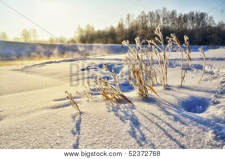 Winter Landscape With Sun And River