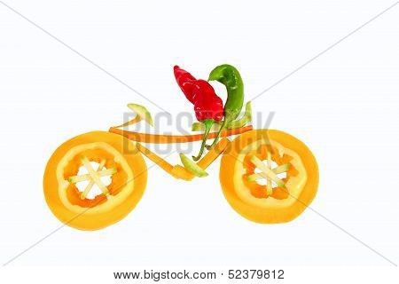 Healthy Eating. Two Little Funny Peppers On Bicycle.