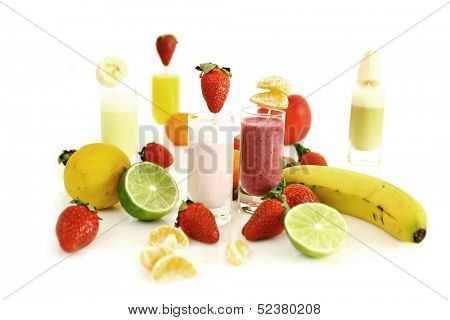 FIve strawberry smoothies and fresh fruits