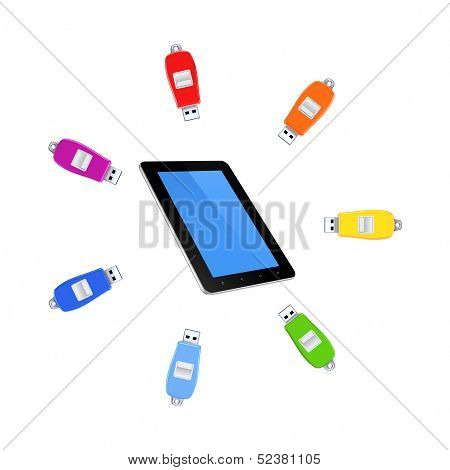 Colorful flashdrives around tablet PC.