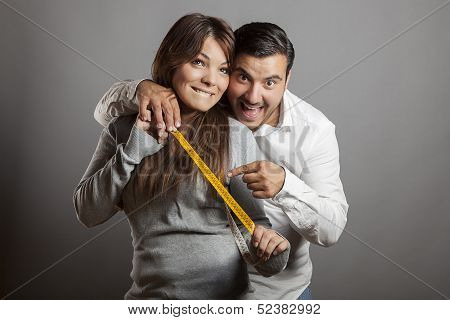 Happiness and boldness couple showing off sex length