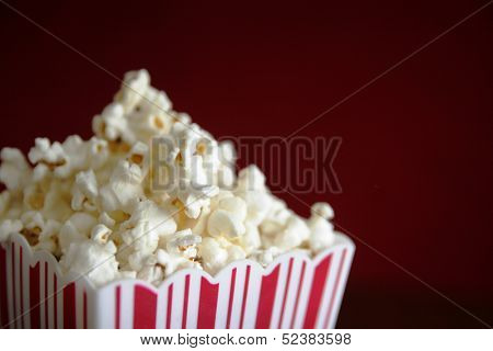 Close up of a pop corn container full of pop corn