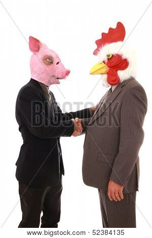 Two business man with animals mask, pig and chicken shaking hands on a white background