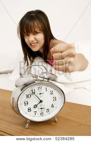 Teenager angry about her alarm clock in the morning