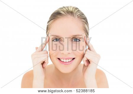 Happy fresh blonde woman touching her temples on white background