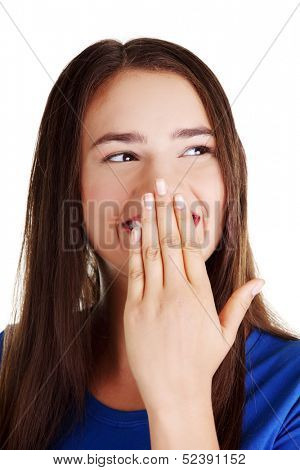 Woman covering mouth with hand,