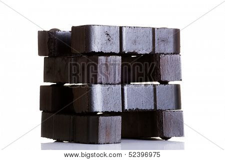 Lignite coal briquette, isolated on white