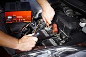 image of internal combustion  - Auto mechanic working in garage - JPG