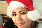image of filipina  - a filipina wearing a santa hat - JPG