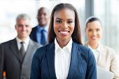 image of in front  - pretty african american businesswoman standing in front of co - JPG