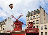 stock photo of moulin rouge  - Big balloon flies over the Parisian cabaret  - JPG