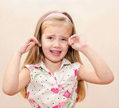 stock photo of disobedient  - Portrait of disobedient crying cute little girl - JPG