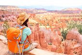 stock photo of thor  - Hiker woman in Bryce Canyon hiking looking and enjoying view during her hike wearing hikers backpack - JPG