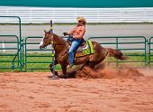 stock photo of barrel racing  - Western horse and rider competing in pole bending and barrel racing competition - JPG