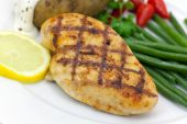 A Grilled Chicken Breast With Baked Tomato