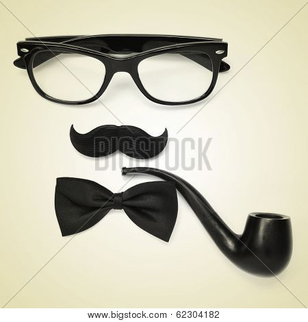 a pair of glasses, a mustache, a bowtie and a smoking pipe on a beige background depicting a gentleman or a hipster guy, with a retro effect