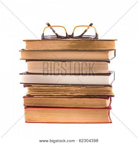 Pile of books and glasses isolated on white background.