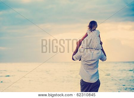 Father and Daughter Playing Together at the Beach at Sunset. Happy Fun Smiling Lifestyle