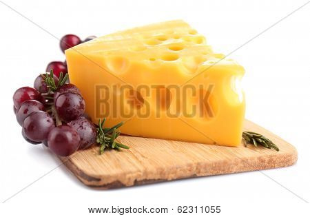 Piece of cheese and grape on wooden board, isolated on white