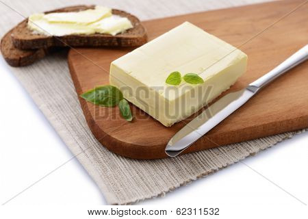 Slice of rye bread with butter, isolated on white