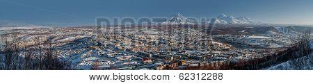 Petropavlovsk-kamchatsky Cityscape. Sunrise Over Koryaksky And Avachinsky Volcanoes