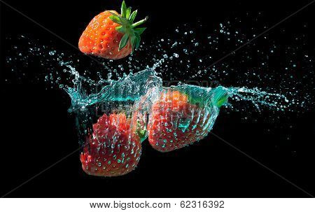 Strawberries Splashed Into Water