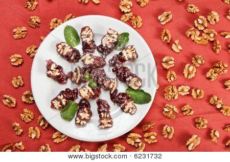 Churchkhela (walnut Roll) on red table-cloth